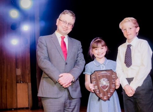 Year 3 pupil Jessica Moffatt and Year 6 pupil Matthew Hawes collect the award on behalf of Diggle School